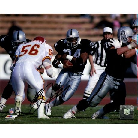Bo Jackson Signed Rushing Against Chiefs Horizontal 8x10 Photo (Signed In Black)