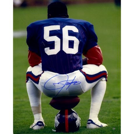 Lawrence Taylor Sitting on Football and Helmet Vertical 16x20 Photo