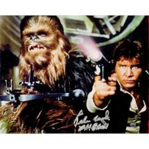 Peter Mayhew Signed 'Chewbacca and Han Solo Defending the Millennium Falcon Episode IV: A New Hope' 8x10 Photo